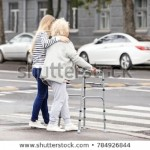 young-woman-helping-her-elderly-450w-784926844